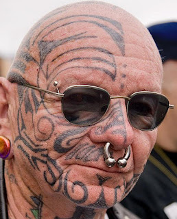 Extreme Face Tattoos and Piercing