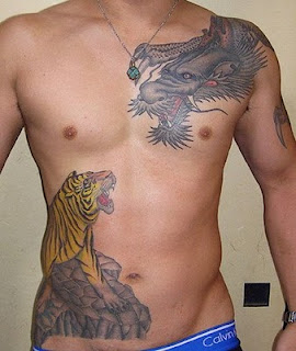 Tattoo in gallery lower stomach tattoos for guys for Tattoos for stomach