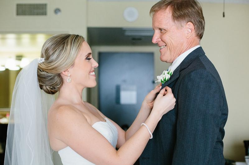 bride pinning boutineer