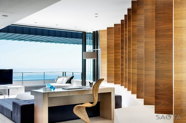 Photo of working desk and the ocean view from the bedroom