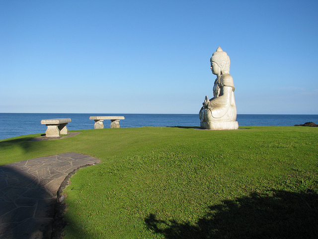 statue of Buddha overlooking the ocean