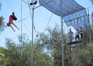 Tori demonstrating the Back Flip Dismount on the Flying Trapeze.