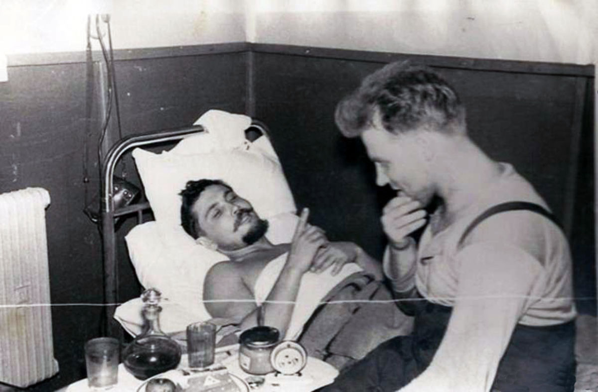 Leonid Rogozov lying down talking to his friend Yuri Vereschagin at Novolazarevskaya.