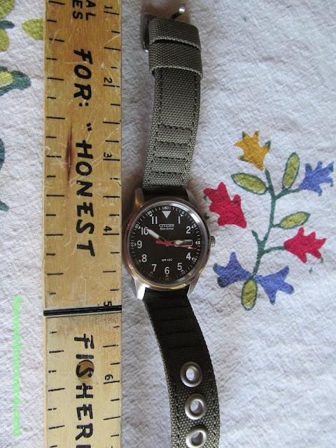 Citizen BM8180-03E Men's Eco-Drive Watch, Shown Next To Ruler
