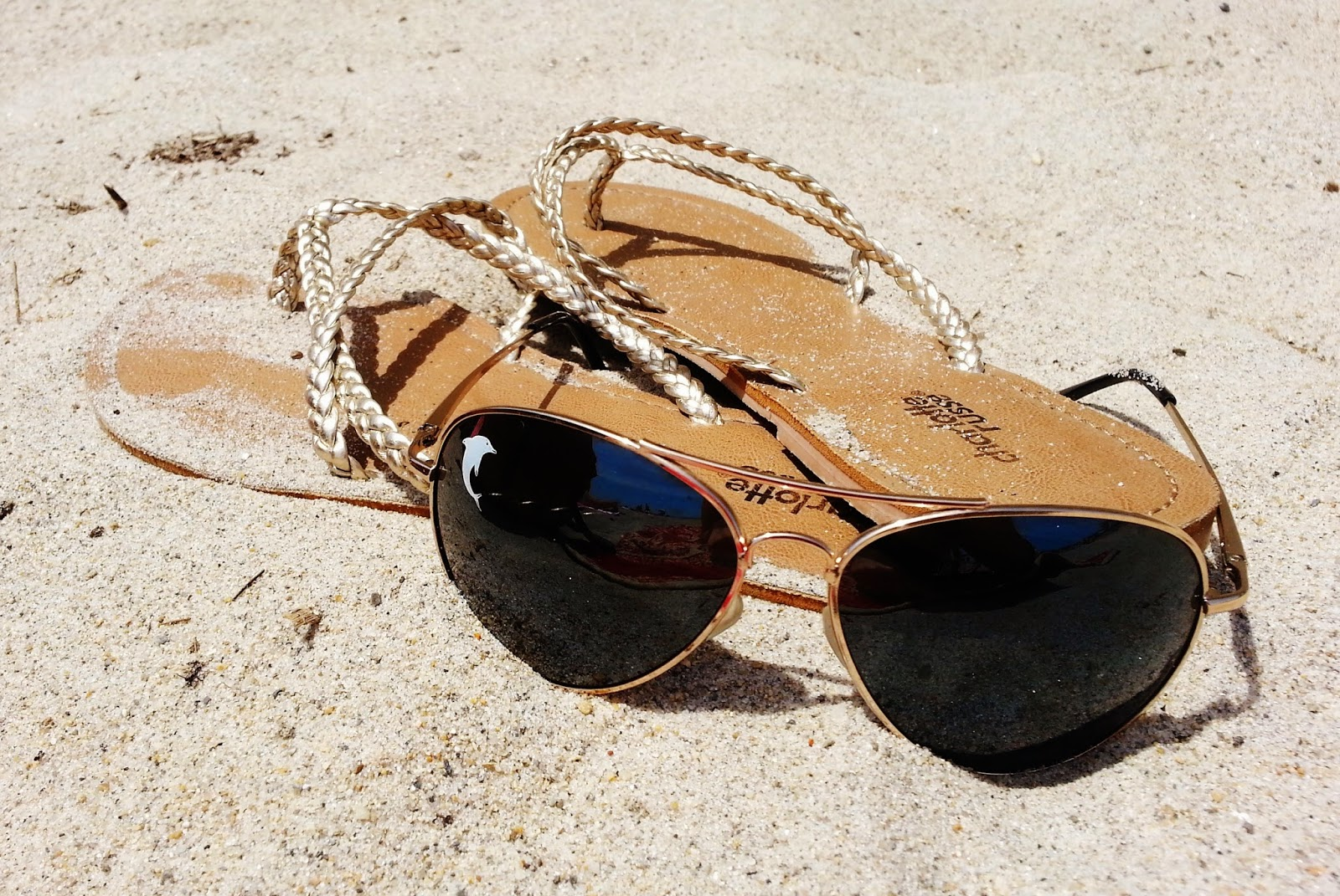 beach sandals sunglasses sand gold flip flops