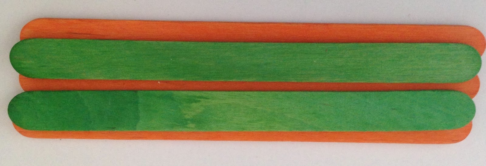 adding green color sticks on orange stick