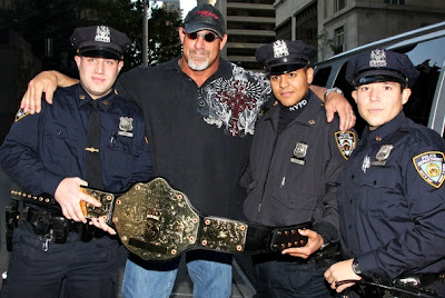 Goldberg with his belt along cops