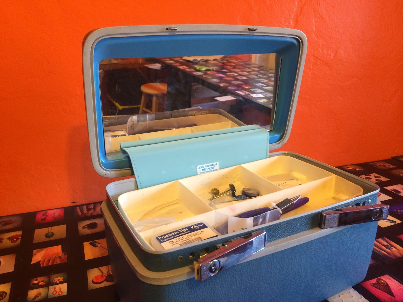 Inside of a blue vintage luggage toolbox. Used to hold metalsmithing supplies.