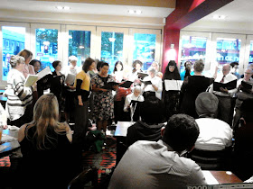 COMMUNITY SINGERS ENTERTAIN PUB GOERS:
