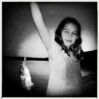 girl catching a fish