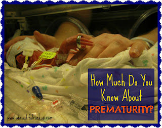 Preemie baby holding wedding ring