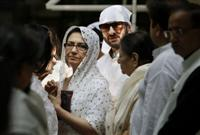 Bollywood actor and wife Sharmila Tagore, center left, and son Saif Ali Khan, center right, attend the funeral of Mansur Ali Khan Pataudi in New Delhi, India, Friday, Sept. 23, 2011.