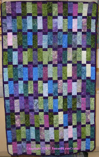 strippy quilt in batiks