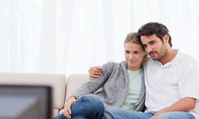 Is TV Romance Bad for Your Relationship? - man woman watch tv home