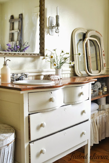 A dresser vanity / A beautifully reclaimed bathroom tour by Faded Charm, featured on http://www.ilovethatjunk.com