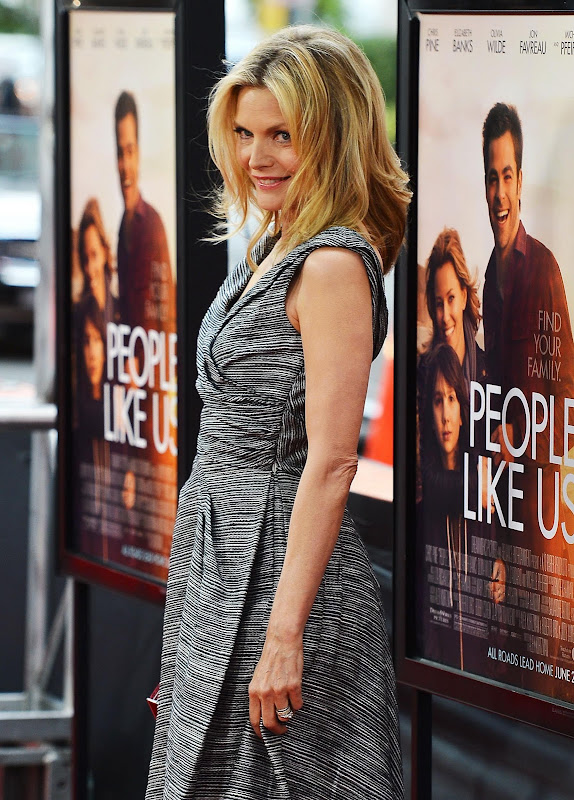 Michelle Pfeiffer posing for photographers at People Like Us Premiere