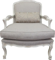 The bergere chair has exquisite detail with its hand carved european beech frame