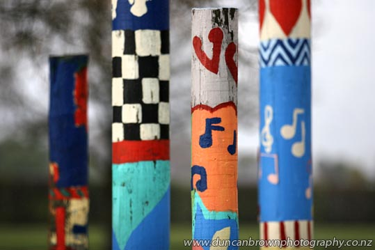 Painted poles at Heretaunga Intermediate School, Hastings photograph