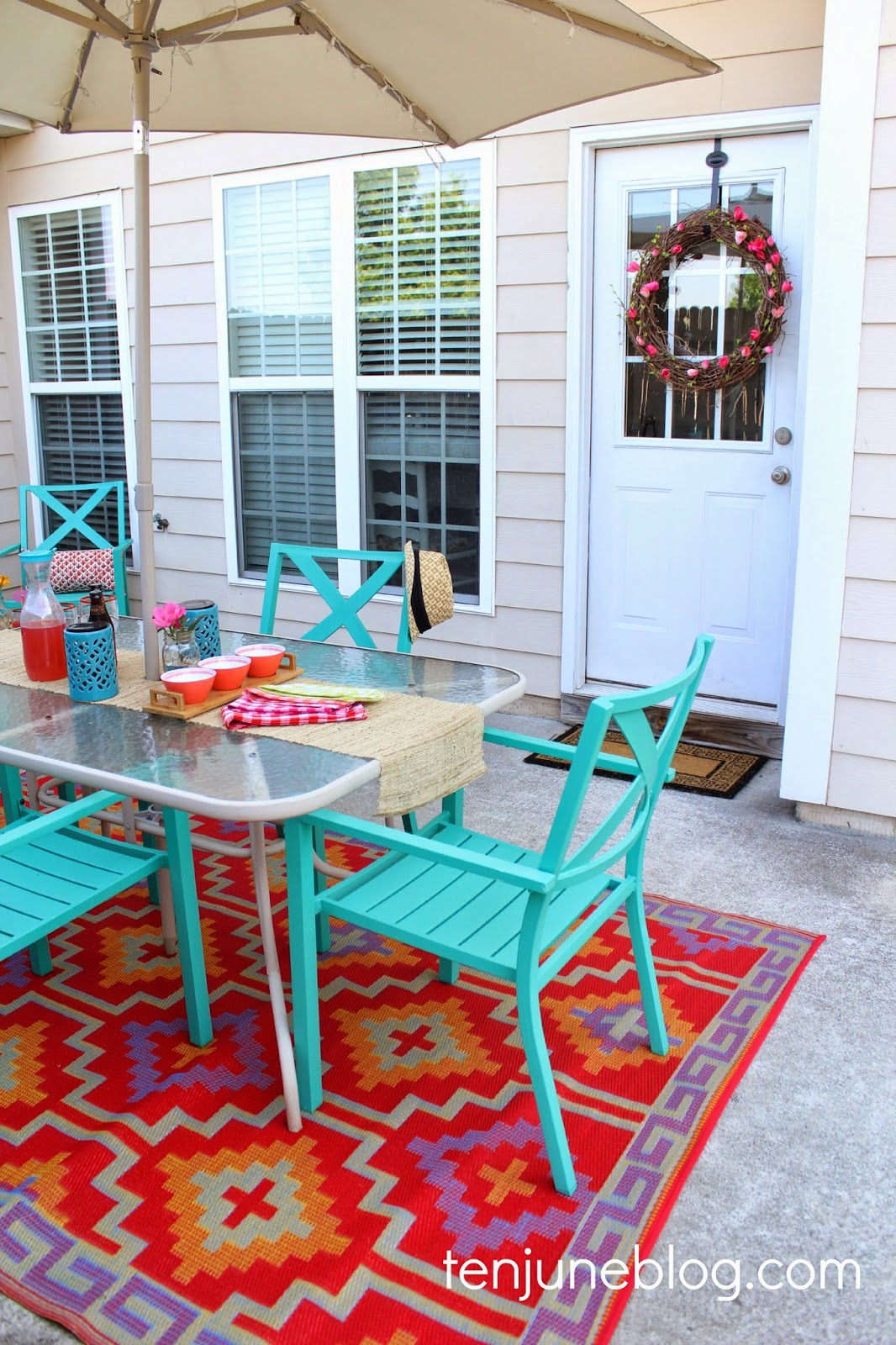 Ten june colorful outdoor patio makeover reveal for Outdoor rugs for deck
