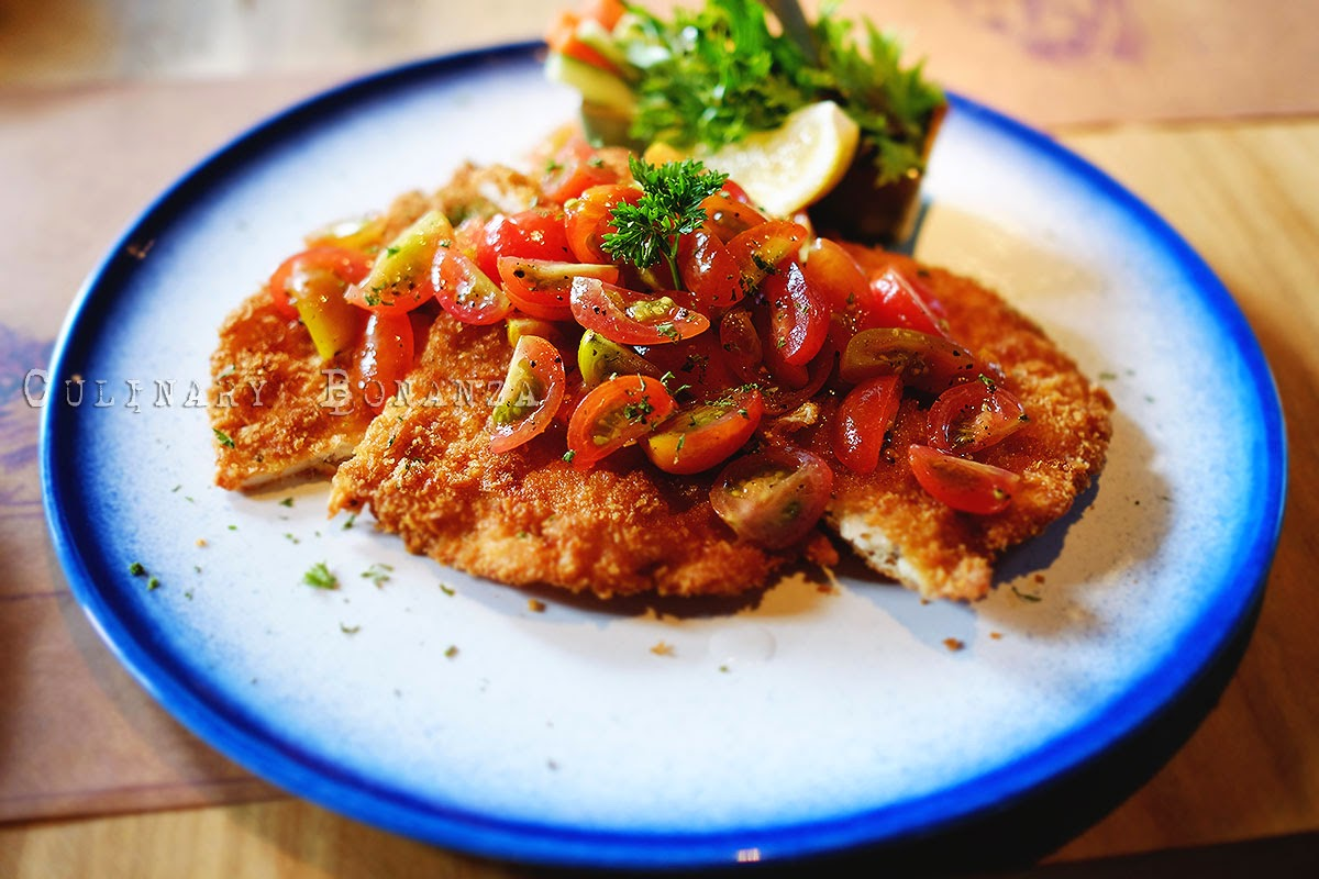chicken Milanese with marinated cherry tomatoes and basil