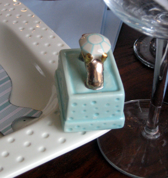 This mini ceramic engagement ring in a box is great decor for this themed brunch.
