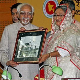 Vice-President Mohammed Hamid Ansari receives a photograph from Bangladesh Prime Minister Sheikh Hasina at the inauguration of 150th birth anniversary celebration of Rabindranath Tagore in at Dhaka on Friday.