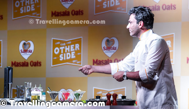 Yesterday we had an invite to participate in a Blogger Meet organized by Saffola Masala Oats and Vikas Khanna was main guest there. He flew from US to India for this event and it was really an exciting opportunity for us to interact with one of the best Chefs in the world. After meeting I found him a great person as well.Let's check out this Photo Journey and know more about my personal experiences of this sepcial day with Bindas Punjabi who is based in US now.   Usually such blogger meets are great ways to interact with other bloggers from North India, but this time most of the bloggers were excited to meet Vikas Khanna in Person. Almost every blogger was on time and as expected Chef Vikas Khanna made us wait for some time but it was worth. As he joined us at Blue Frog with his amazing smile, the whole environment changed immediately. Probably I was least aware of him. I knew very basic stuff about him and everyone else had probably all details about his past life and his lifestyle. Girl Bloggers were really mad about the event and we could literally see lot of unusual stuff that doesn't happen during other meets. Anyways, it was great to meet him in person and understand the great Chef.   I loved when we started talking in Punjabi & Hindi, although he couldn't control to talk in English in between. His style was awesome and he was continuously cracking some subtle Punjabi jokes in between. Of course, he shared some great tips about food and how different ingredients can be used in innovative way.   Born in Amritsar, Vikas Khanna began his culinary experience as a helper in his grandmother's kitchen and learned the art of cooking & the use of spices from her. He talked about his mom many times and related food with love. And had some great views about food and mothers who feed the whole family with love. He began developing recipes at a very young age. He graduated from the Welcomgroup Graduate School of Hotel Administration and established SAANCH, a cultural festi