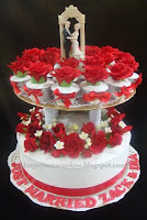 2 tier wedding cupcakes and cake
