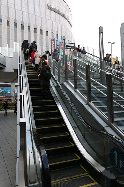 Standing on the right of escalator in order to give way for people who are on the quick move in Osaka, Japan