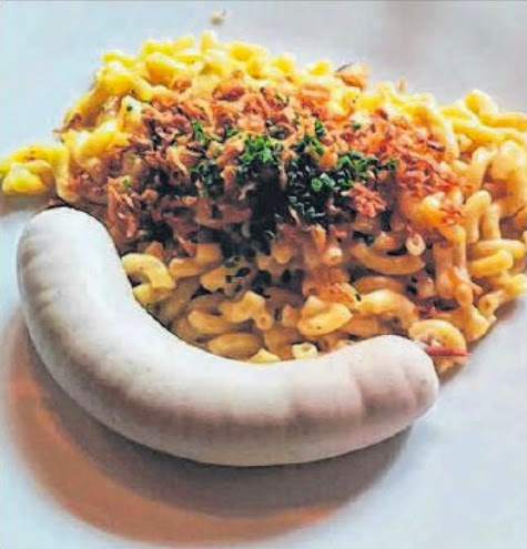 Local favourite: The dish kasehornli, a local version of macaroni and cheese served with a dollop of apple sauce and siedwurst, or Swiss white beef sausage.