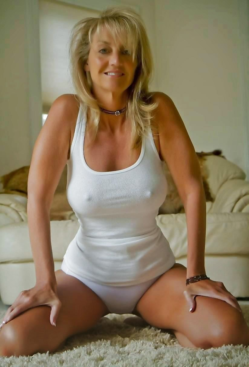 image Blonde milf in white stockings fucked and licked to orgasm