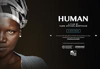 Portada de Human con el rostro de una mujer