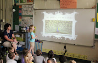 Student presenting a presentation to her class