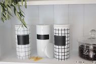 Zwart-wit porseleinen voorraadpotten