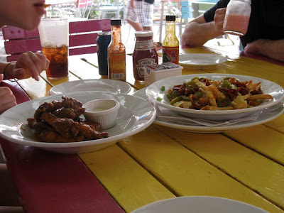 Wings and cheese fries at Smokey Joe's, Aruba