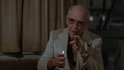 Burgess Meredith as Ben Greene in Richard Attenborough's Magic, smoking his cigar, asks Corky to keep the dummy quiet for five minutes, Magic, Directed by Richard Attenborough