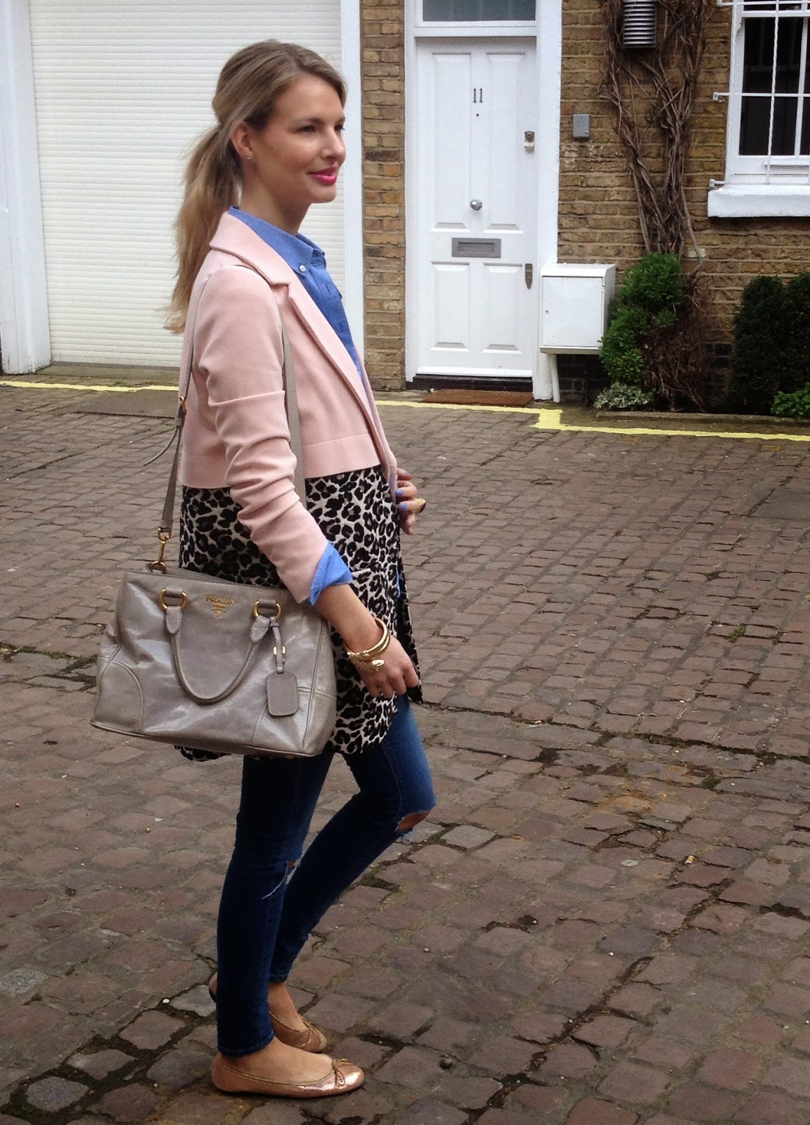 leopard print coat, two-toned coat, pink coat, pink leopard print coat, pastel colour cout, patel pink coat, ripped jeans, asos jeans, street style, chrissabella blogger, prada, prada handbag, anna dello russo bracelet