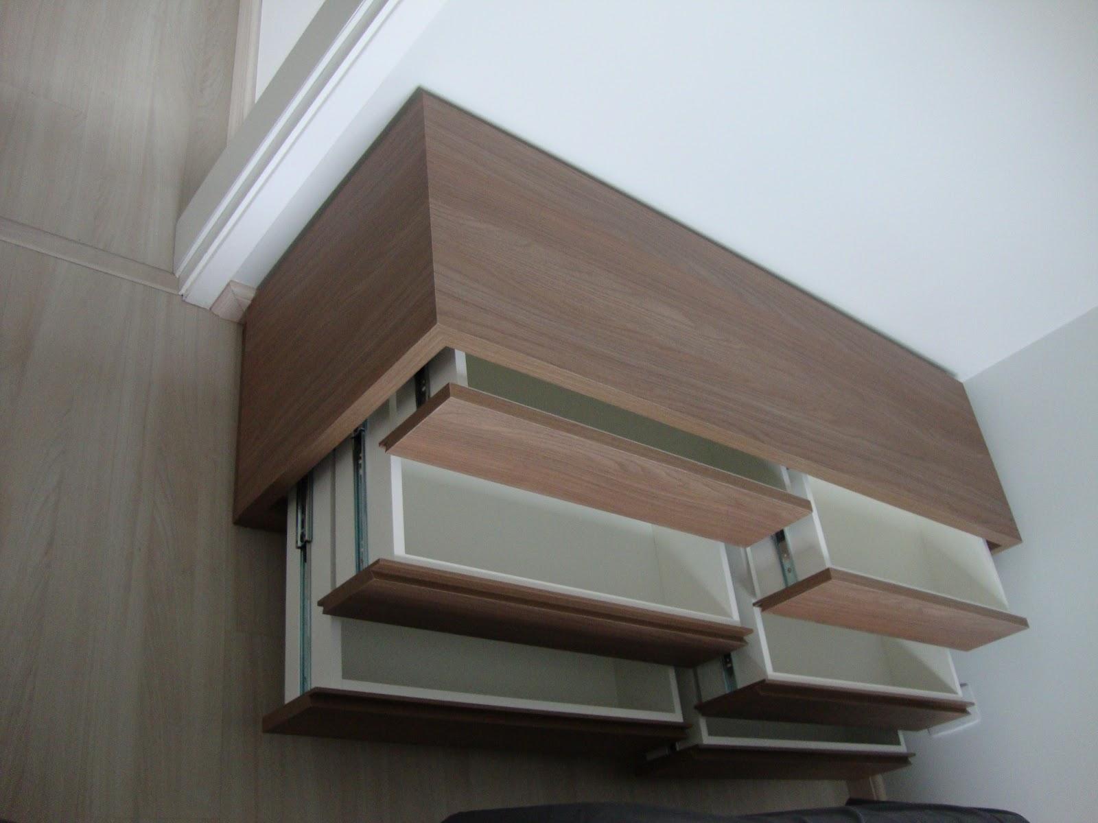 criamos um móvel baixo em mdf madeirado com seis gavetas bem largas  #51677A 1600x1200