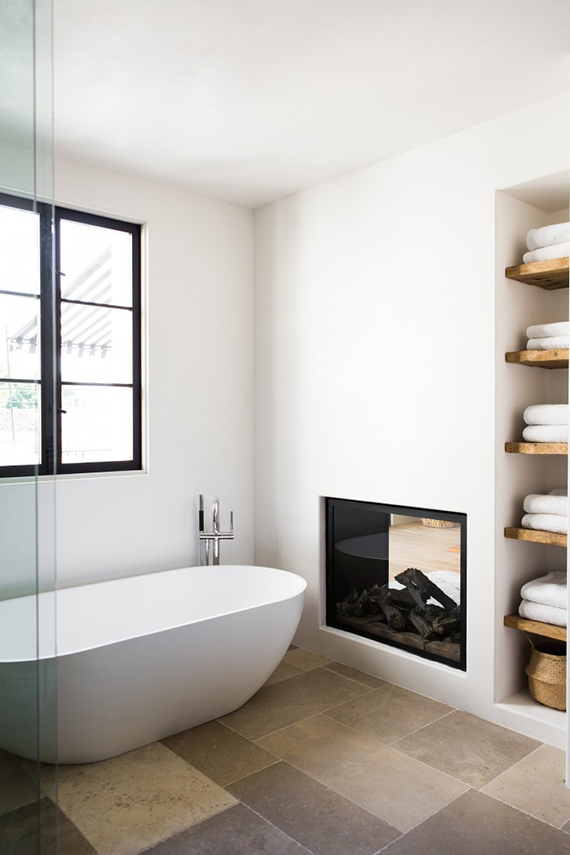 Modern country bathroom with fireplace| Photos by Laure Joliet via Remodelista