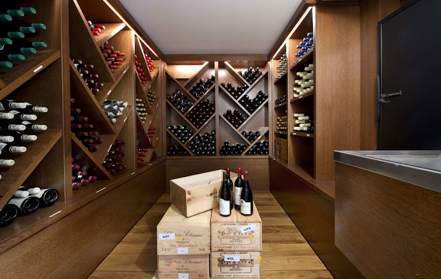 Nice small modern vine cellar with brown shelves