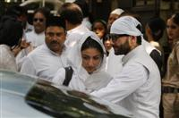 Bollywood actors and children Soha Ali Khan, left and Saif Ali Khan attend the funeral of Mansur Ali Khan Pataudi