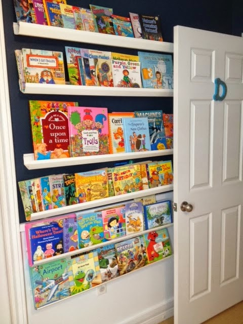 Our son's rain gutter bookshelves