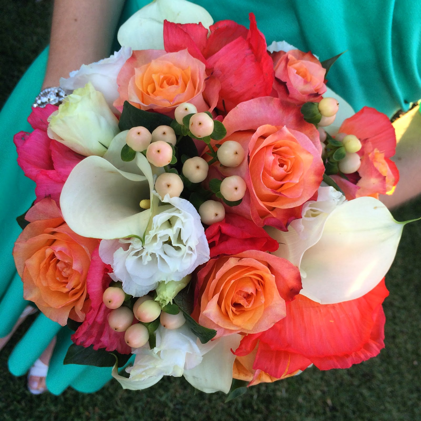 Urban flower bri and ians wedding flowers bridesmaids she wanted whitecoral bouquets she didnt really specify any flower types just left jules with the colour of the bridemaids dresses a mightylinksfo