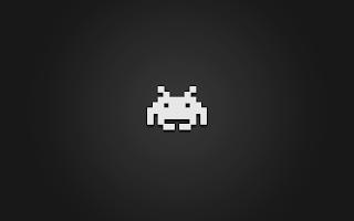 Clean and dark Space Invaders desktop wallpaper