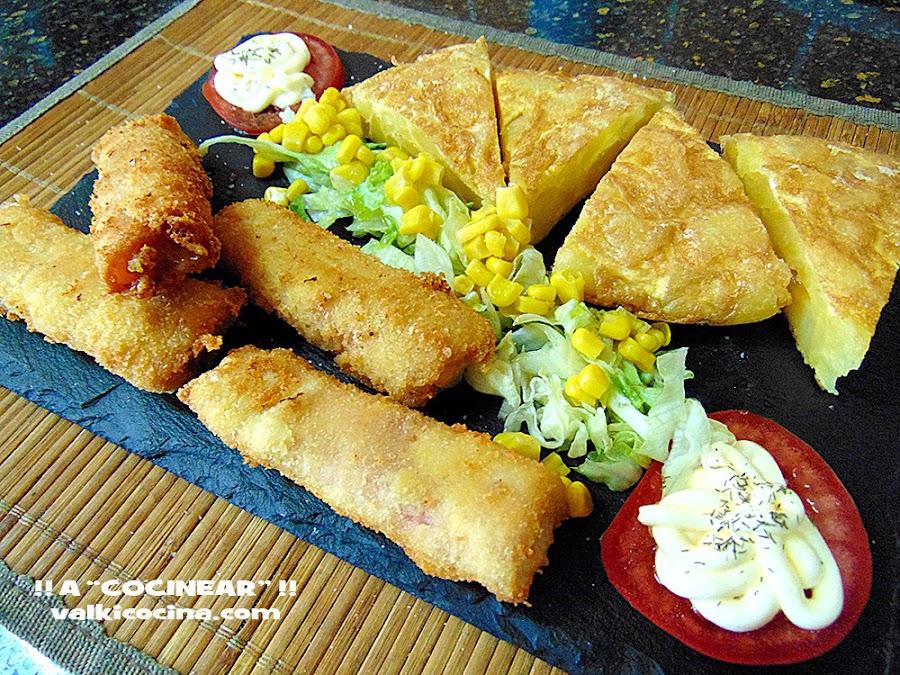 Rollitos de jamón cocido y queso rellenos de pollo