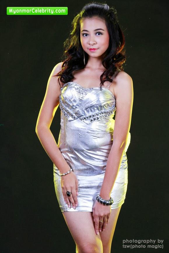 Model Hnin Si Wine in pretty Silver Strapless Mini Dress.