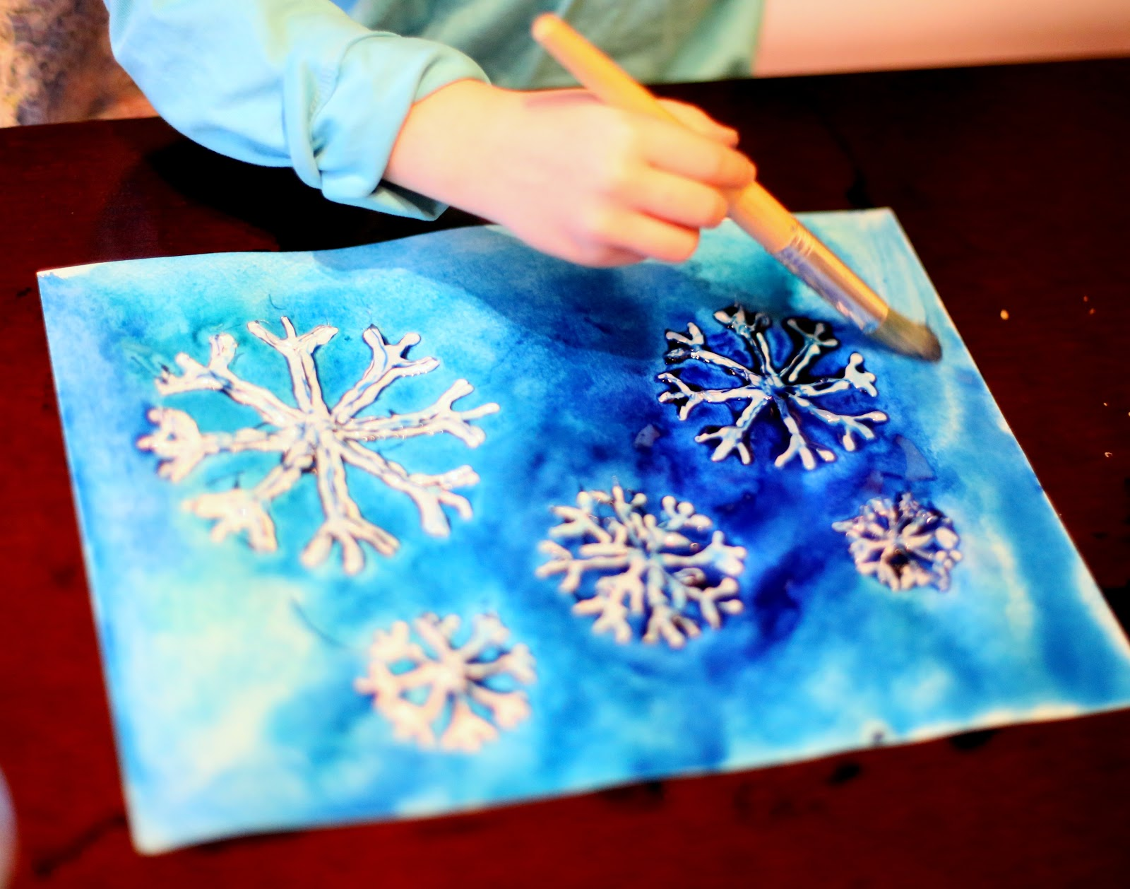 winter watercolor resist art with free printable snowflake template from fun at home with kids - Printable Art For Kids