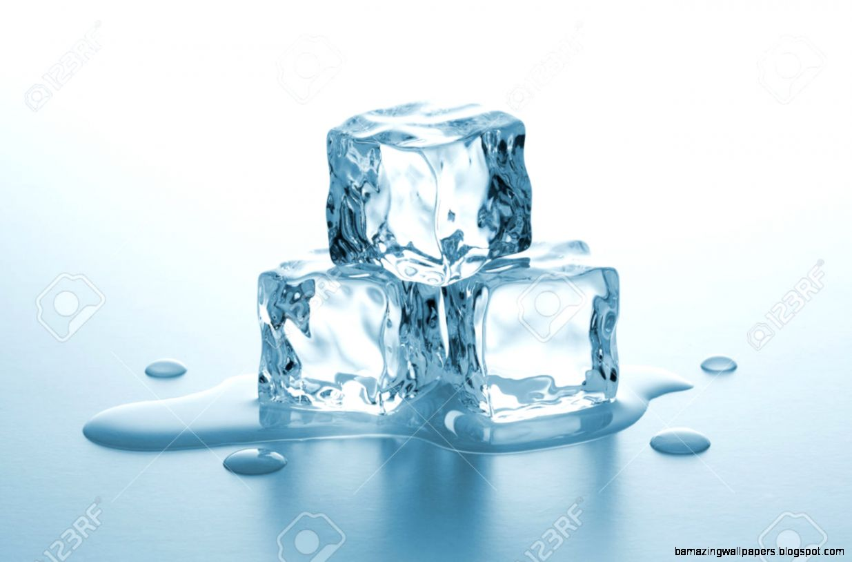 Pile Of Ice Cubes Melting With Drops Of Water On Gradient