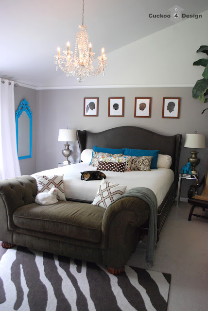grey bedroom with turquoise accents and brown button tufted corduroy chaise