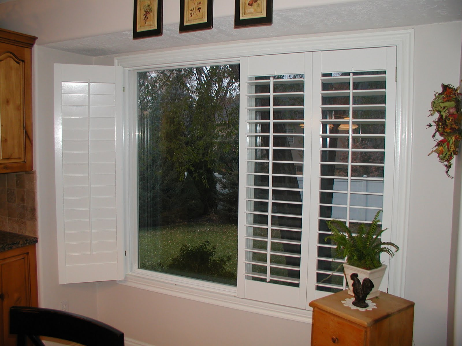 Stanfield shutter co accordion plantation shutters fold em 39 as you like for Bifold interior window shutters